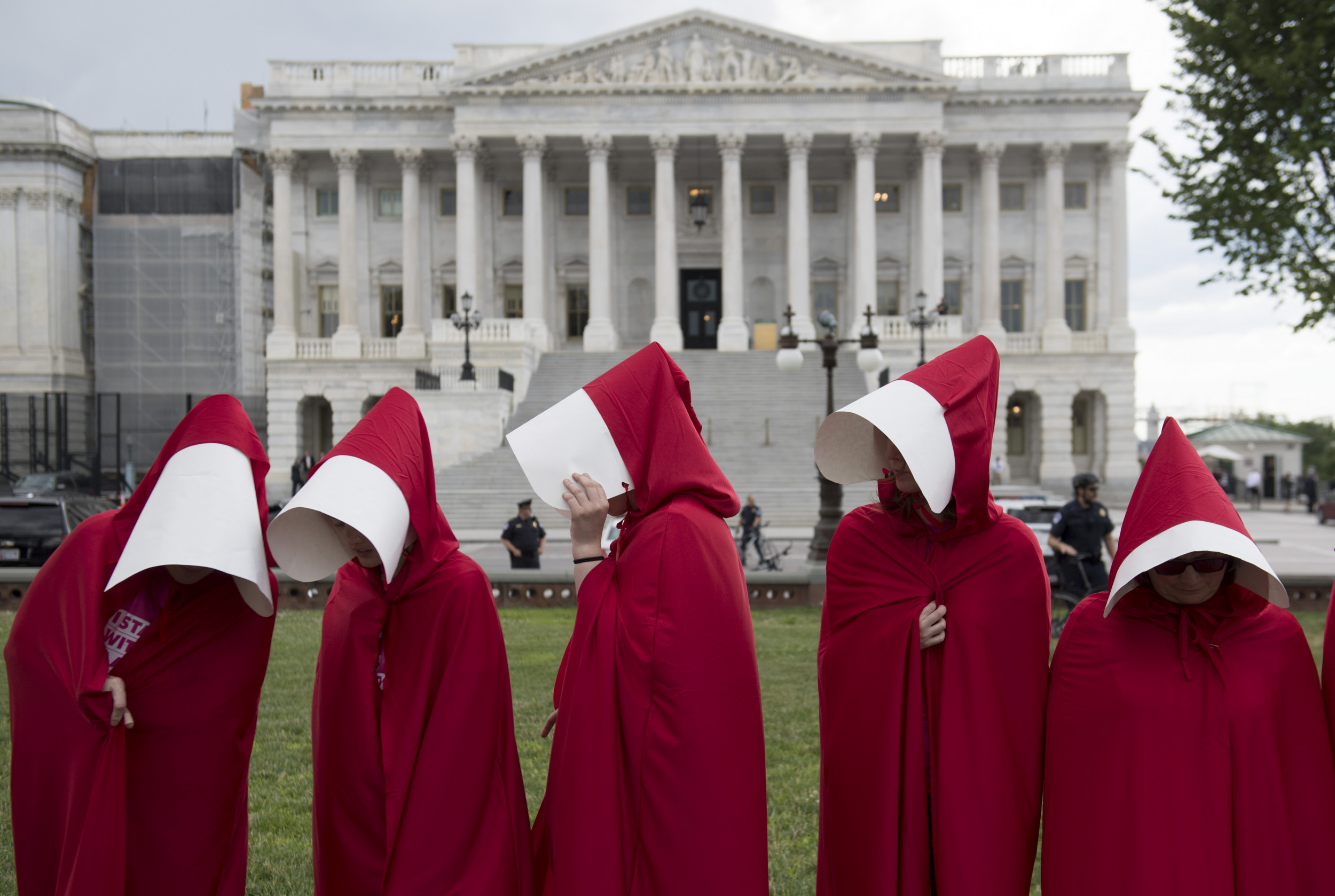 How Charismatic Catholic Groups Like Amy Coney Barrett's People of Praise  Inspired 'The Handmaid's Tale'