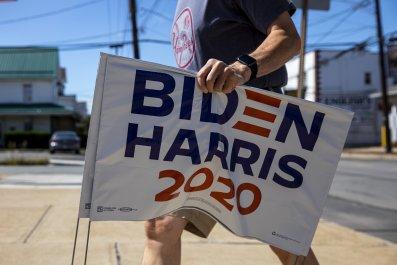 Police officer son steals Biden yard signs