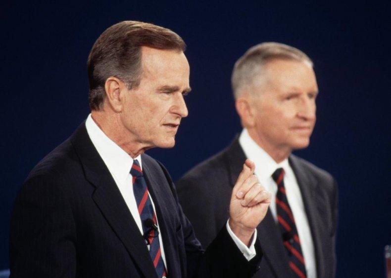 1992: President George H.W. Bush checks his watch