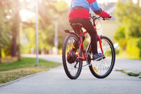 Child rides a bike