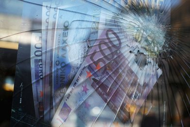 Euros behind broken glass