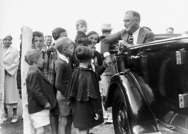 1934: President Roosevelt in car greeted by son Elliott
