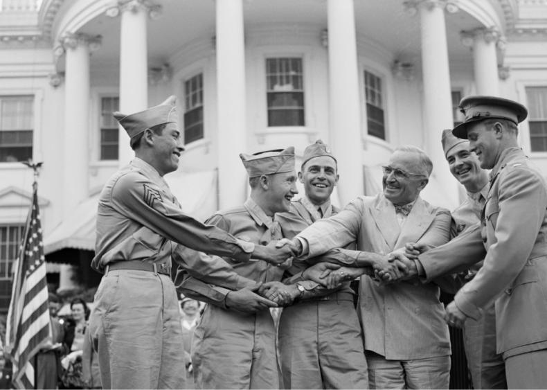 1946: President Harry S. Truman congratulating servicemen