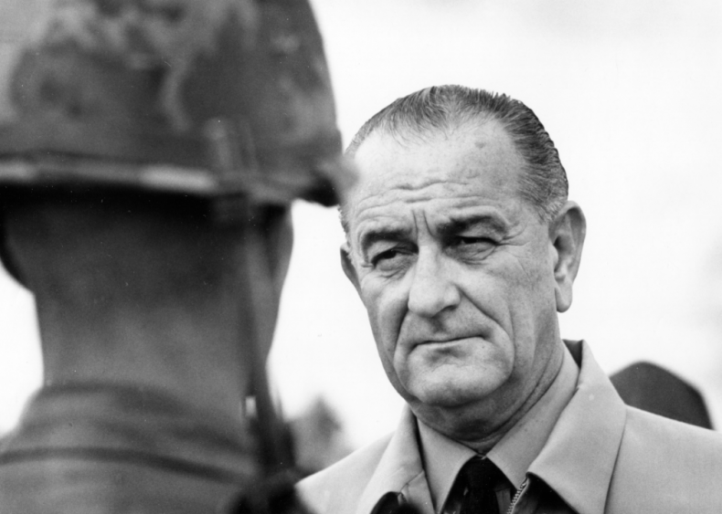 1966: President Johnson inspects a marine