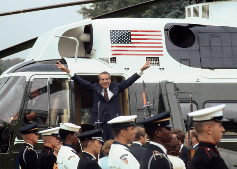 1974: Richard Nixon giving victory sign after resignation