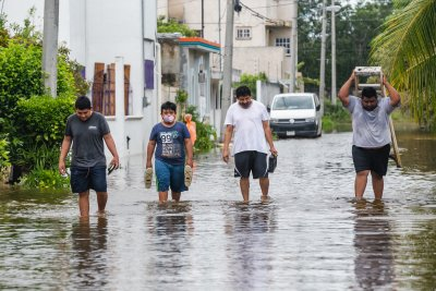 Hurricane Delta Cozumel Flooded Street People Walking