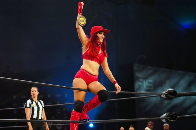 aew ivelisse womens tag team cup medal