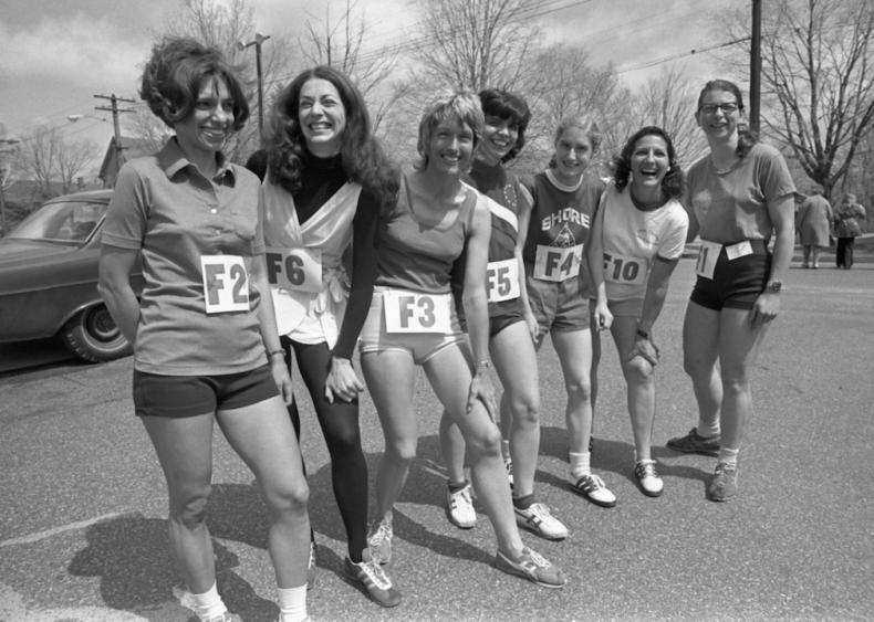 Women run the Boston Marathon in men's sneakers