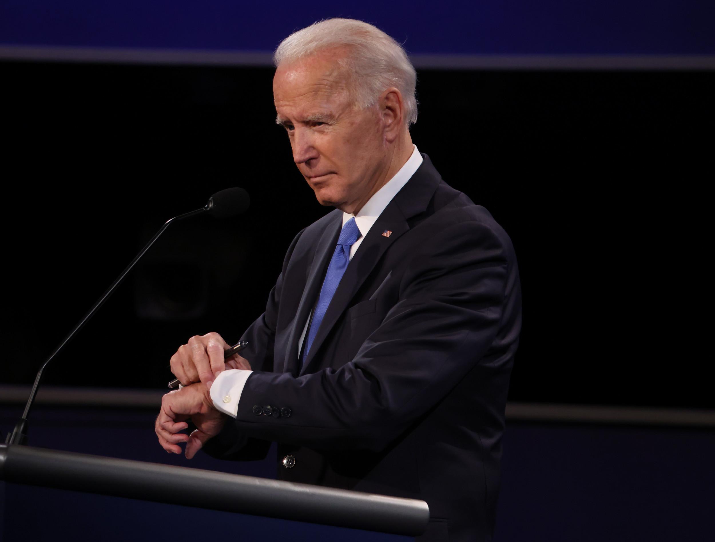 Joe Biden looking at his watch during debate sparks jokes, Republican outrage