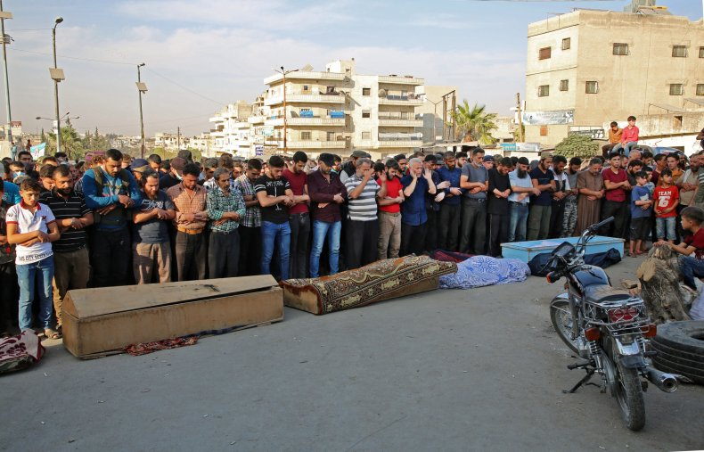 syria, idlib, rebel, funeral, russia, strikes