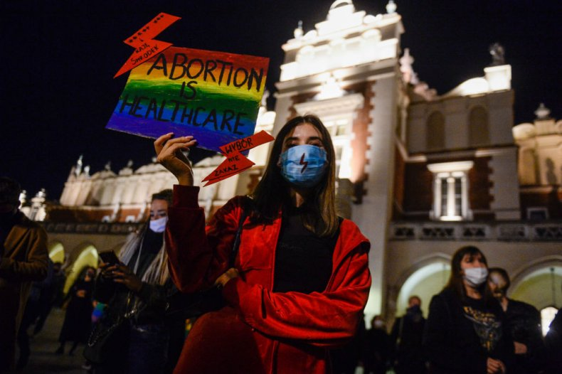 Poland abortion protester holds sign in Krakow
