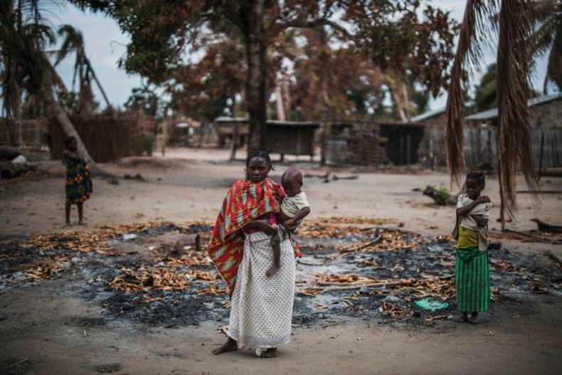 Woman holds baby in Cabo Delgado village