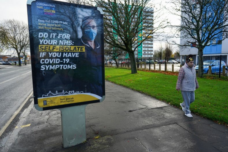Woman passes COVID sign in Hull