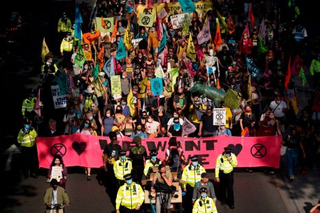 Extinction Rebellion activists march through London