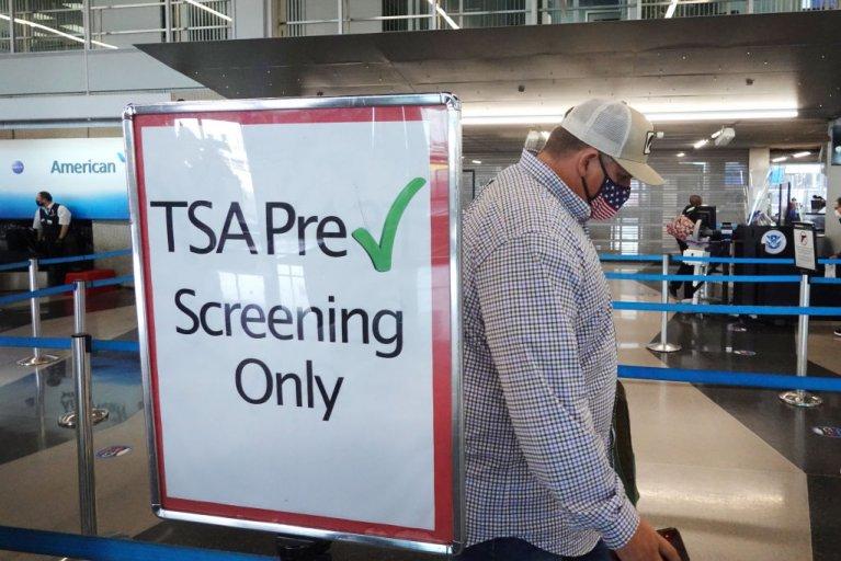 A Passenger Enters a TSA Checkpoint