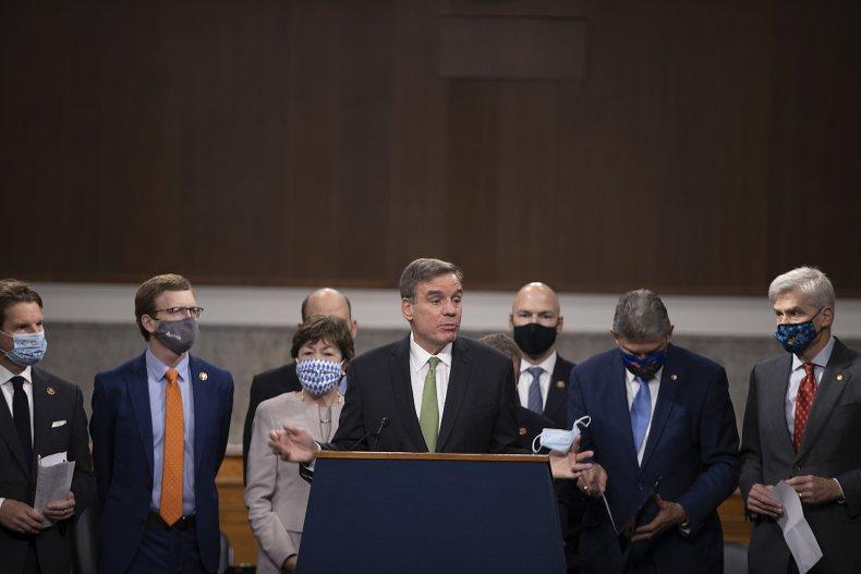 Mark Warner speaks with bipartisan senator group