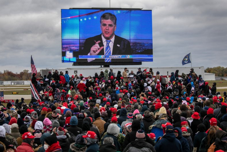 Trump supporters watch Hannity at Michigan rally