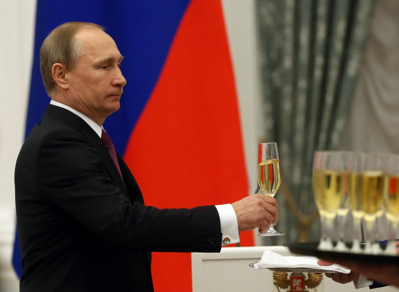 Russian President Vladimir Putin with champagne