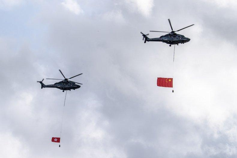 Chinese and Hong Kong Flags Fly