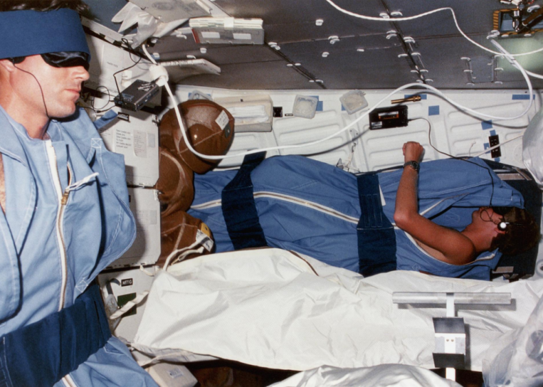 Outer space: Astronauts sleep in restraints