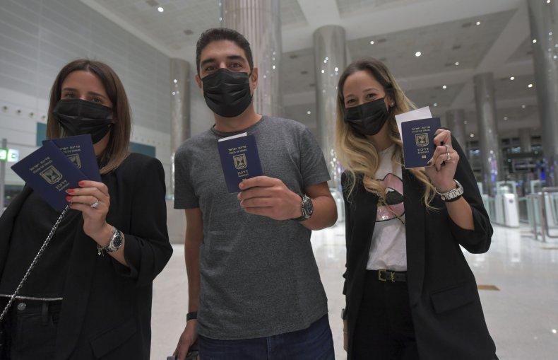 Israelis flash their passports at the Dubai