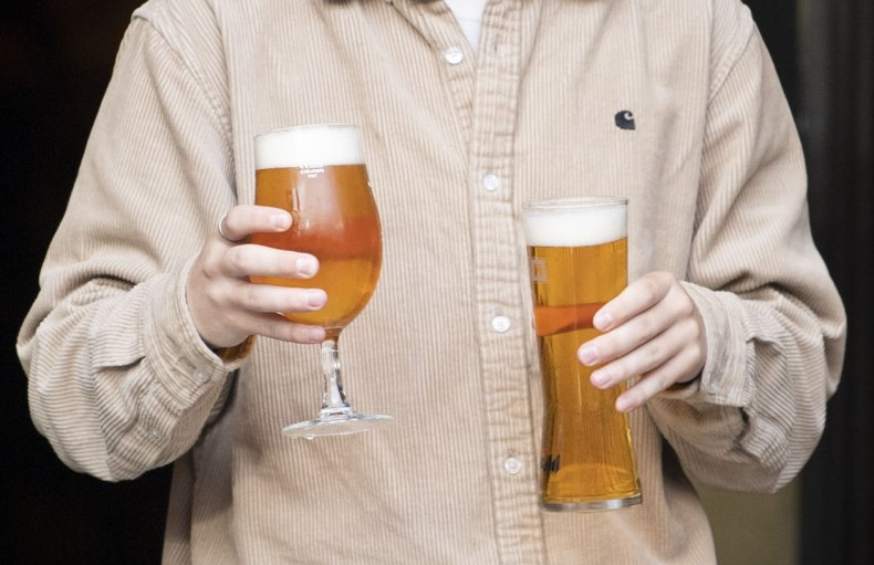 Worker carries two beers