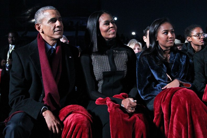 Sasha Obama with her parents