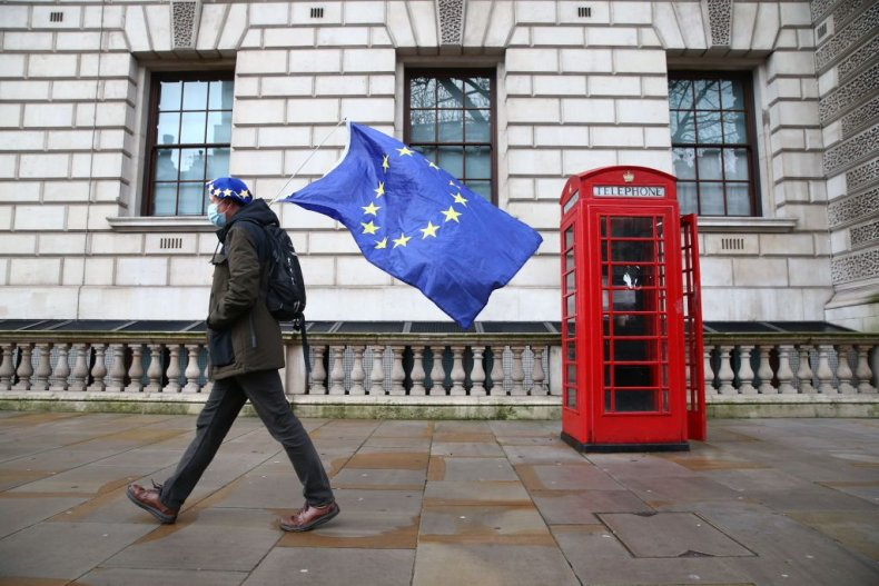 Man carrying EU flag by London phonebox