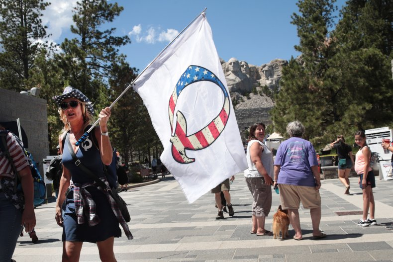A Trump Supporter Holding a QAnon Flag