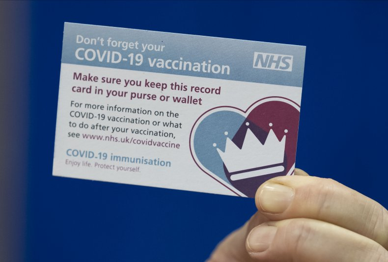 COVID-19 vaccination card Wales hospital December 2020