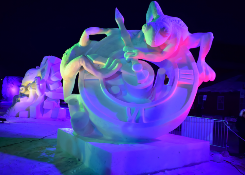 Frogs on a clock snow sculpture in Breckenridge, Colorado