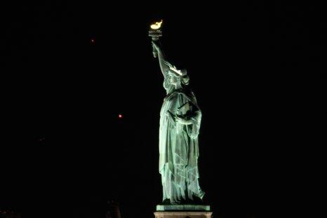 Saturn and Jupiter behind Statue of Liberty