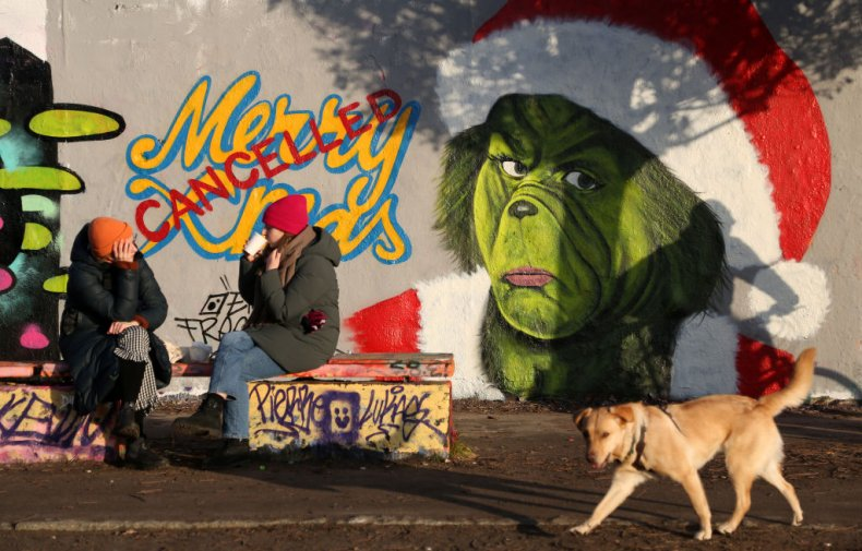 Berlin Wall COVID Christmas cancelled graffiti