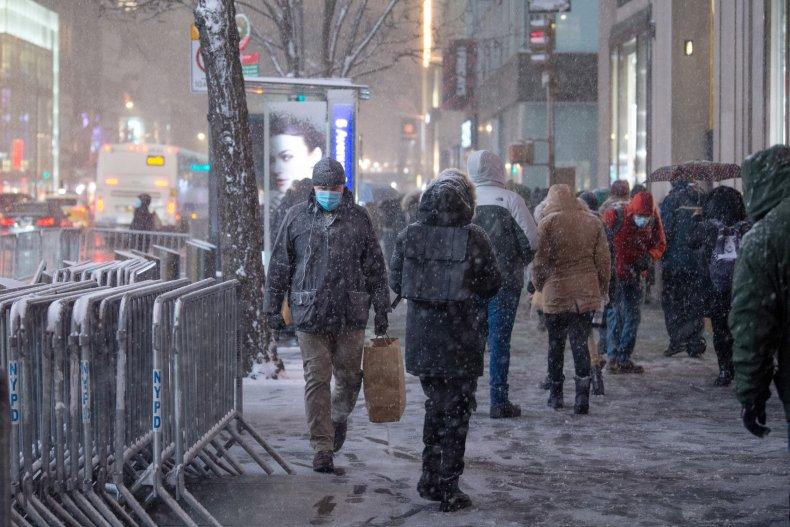 man wearing mask walks through new york