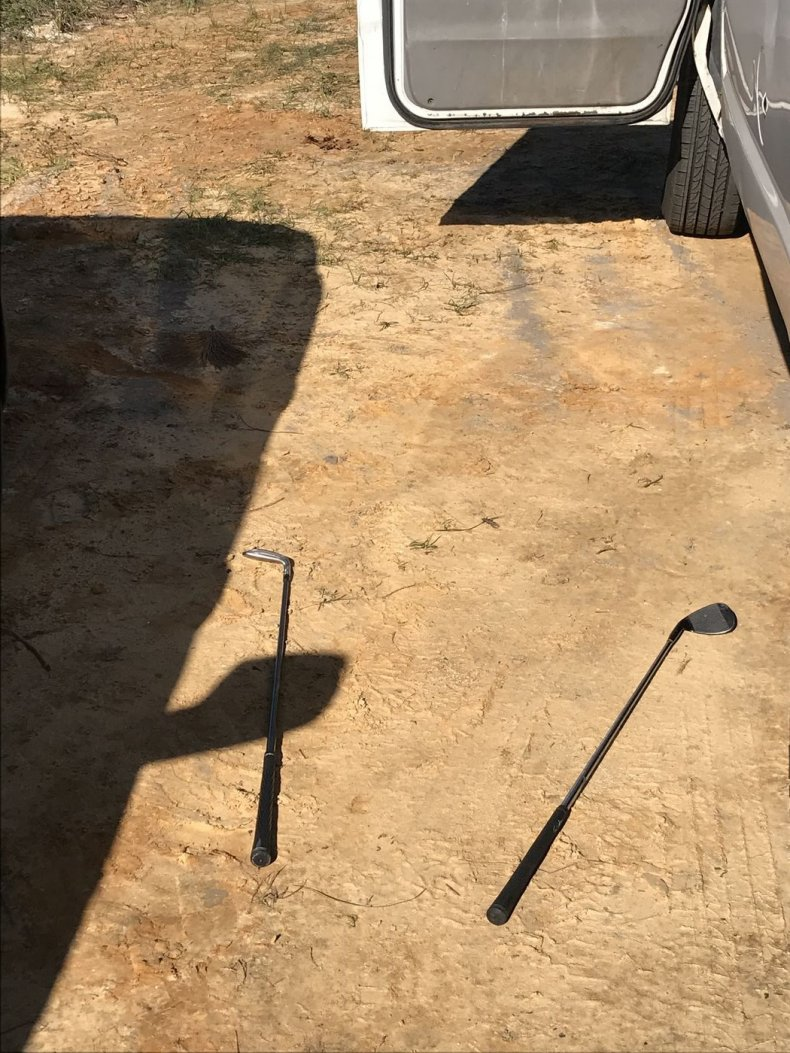 Golf clubs pictured on the ground