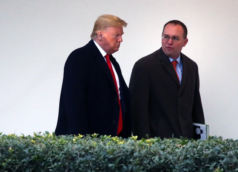 donald trump walks with mick mulvaney
