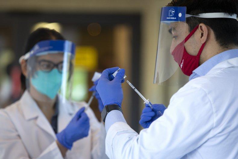 pharmacists prepare covid-19 vaccine doses