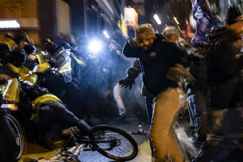 Police officers clash with protesters in Washington