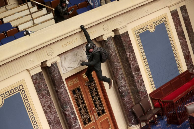 Man hangs from the Senate Chamber balcony