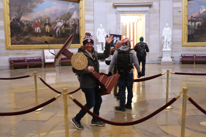 Adam Johnson Carrying Speaker Nancy Pelosi's Lectern