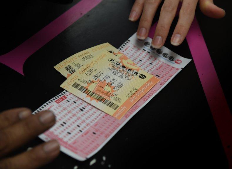 Customers buys Powerball ticket