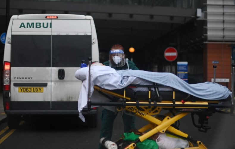 Patient is wheeled from ambulance London UK