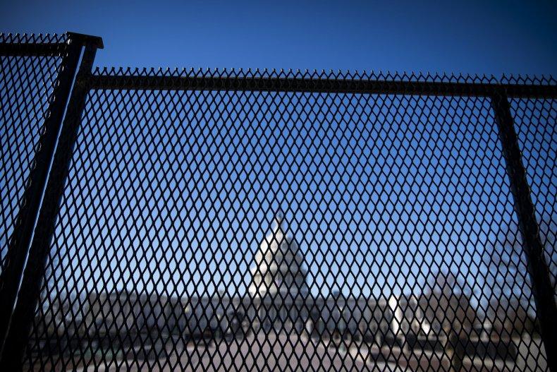 Capitol behind fencing after Trump mob storming