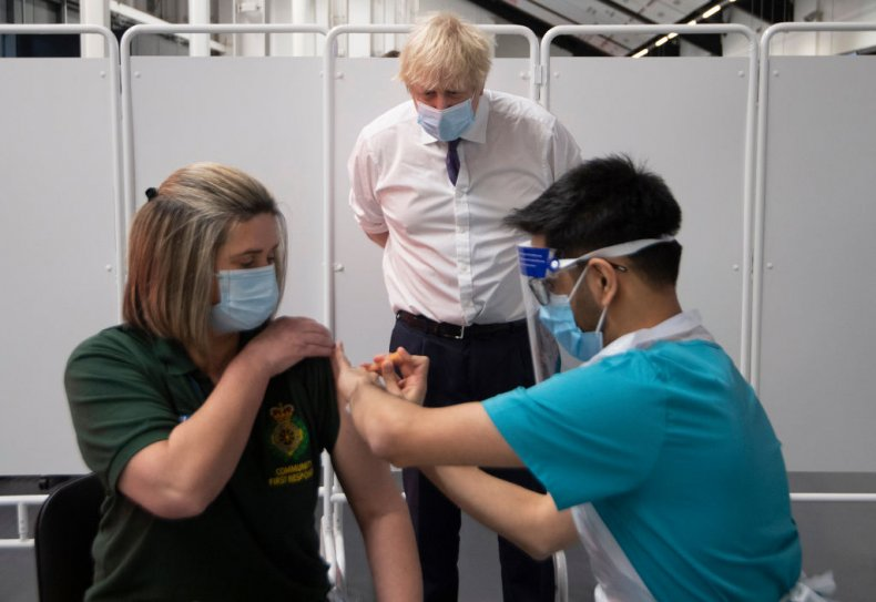 Boris Johnson watches COVID vaccine