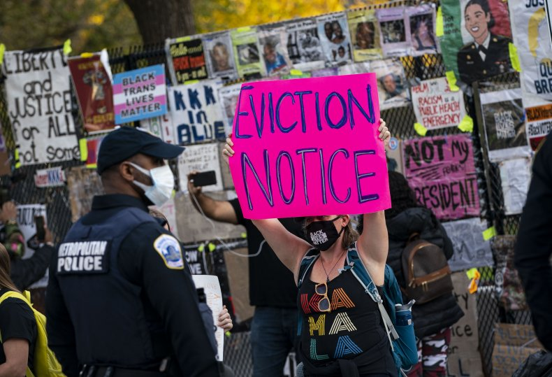 Protester holds sign at police in Washington