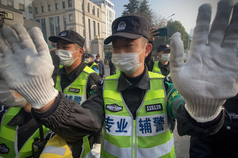Chinese police outside trial of COVID journalist