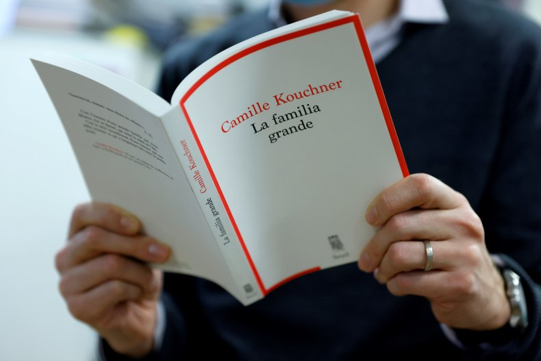 A man reads Camille Kouchner's book
