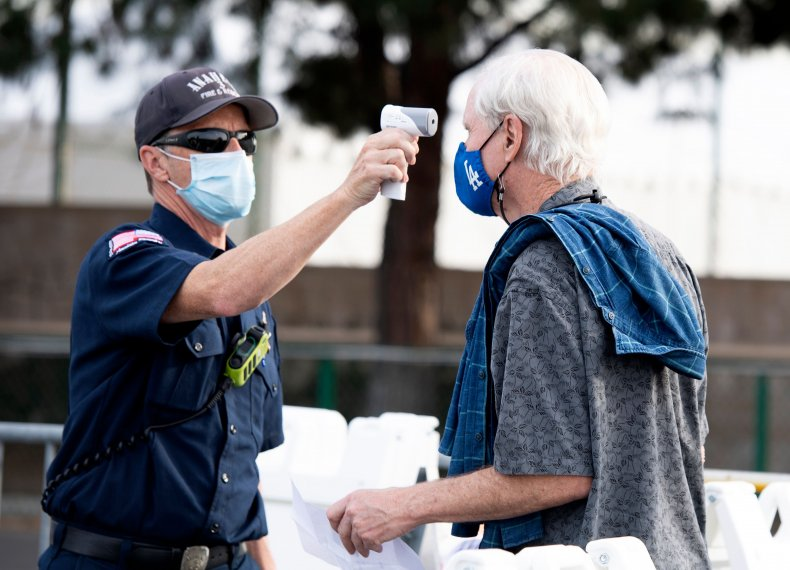man receives COVID vaccine in California
