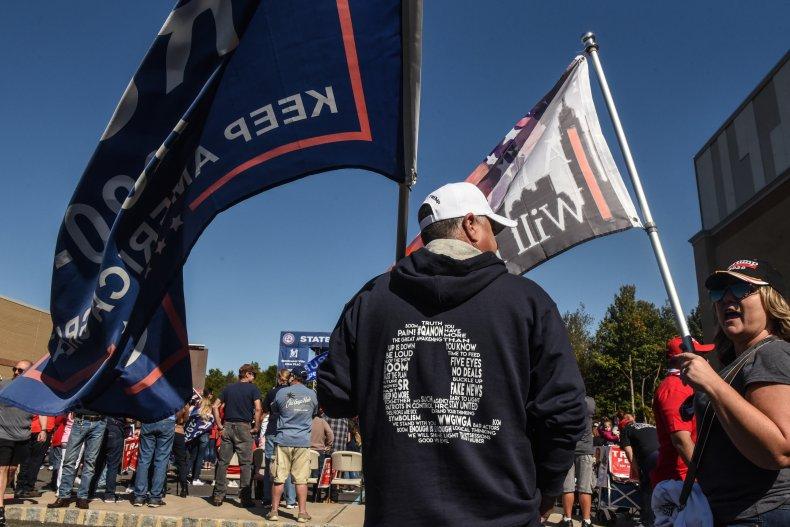 man wears qanon hoodie at trump rally