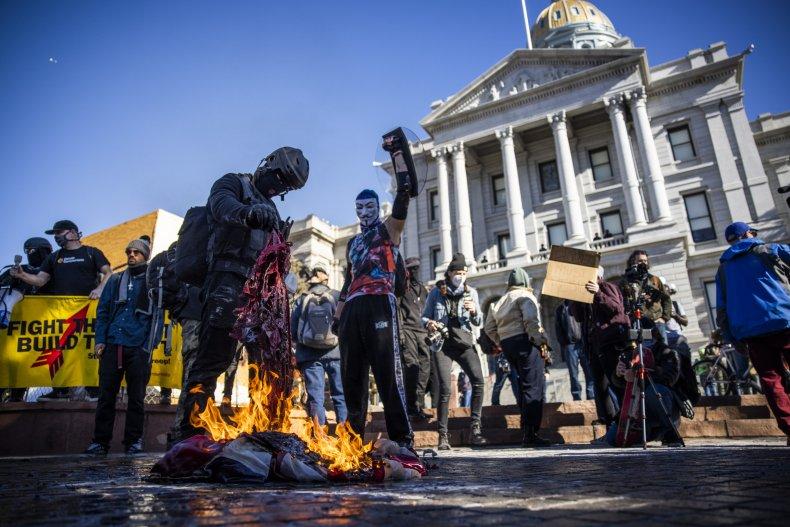 Protesters burn American flag Colorado